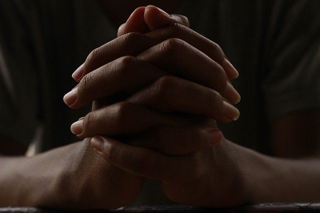 Hands with fingers clasped in a praying position